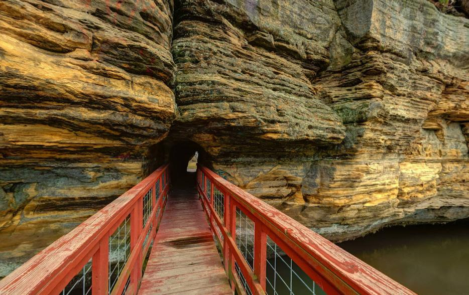 Hike Straight Through A Giant Rock Formation At Pier Natural Bridge Park In Wisconsin