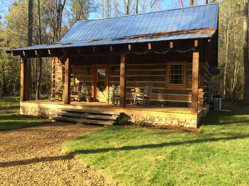 With A Waterfall Nearby, This Rustic Log Cabin In Mississippi Is Great For Getting In Touch With Nature