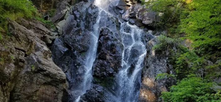 Plan A Visit To Angel Falls, Maine's Beautifully Blue Waterfall