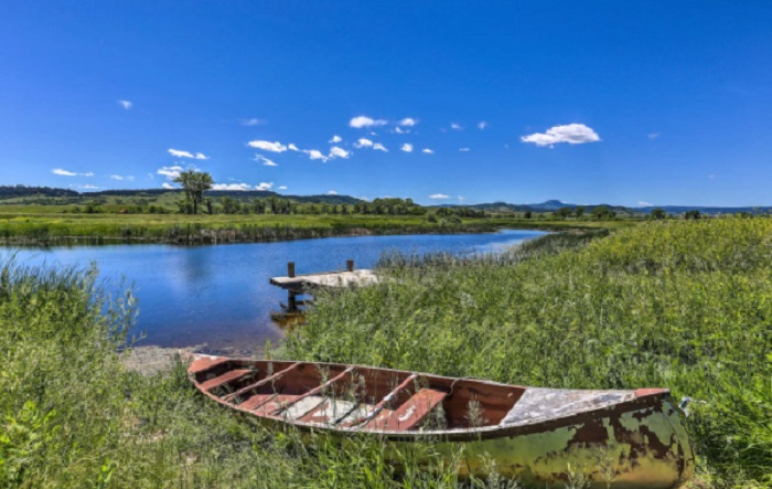 Stay In A Charming South Dakota Cabin With Its Own Private Pond