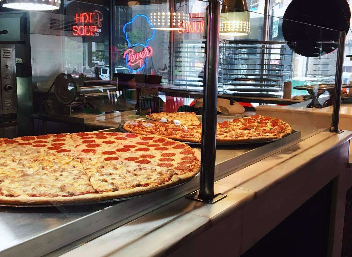 The Gigantic Pizza Served At Bacci Pizzeria In Illinois Is Almost As Big As The Table