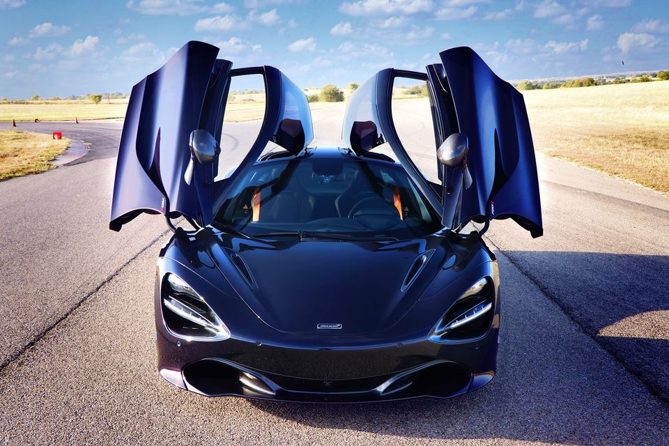 Zoom Around A Racetrack In A Luxury Sports Car At Motor Sports Ranch In Texas